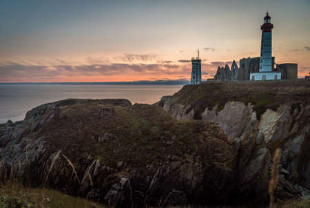 Saint Mathieu lighthouse in Brittany at sunset in France