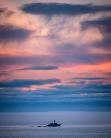 French war army boat in the sunset in Bretagne Archivio Fotografico