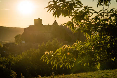 Castelnau castle at sunset in Dordogne valley in France
