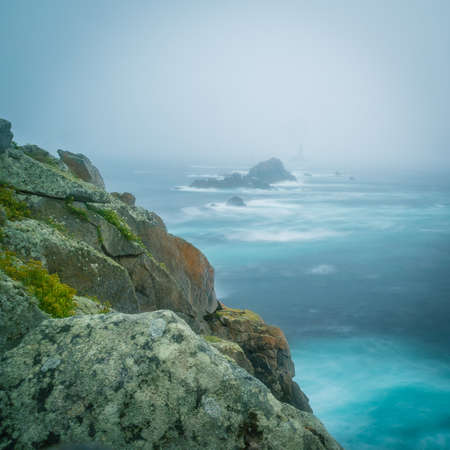 Pointe du raz with clouds and fog under a storm in France