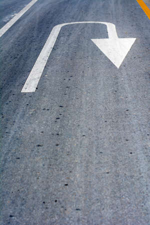 White turn arrow road sign