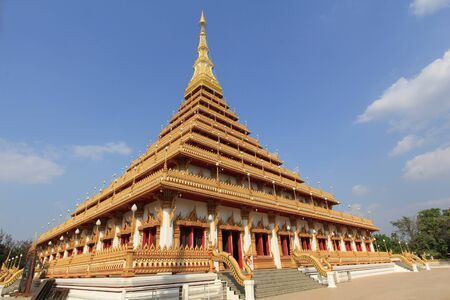 top of golden pagoda at the Thai temple, Khon kaen Thailand photo