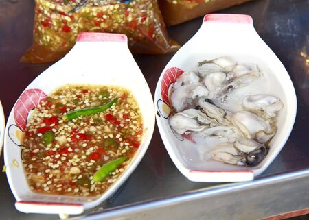 fried oyster with chili sauce.