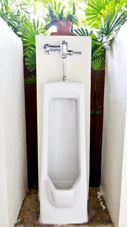 One urinals with a  tree background  Stock Photo - 19980147