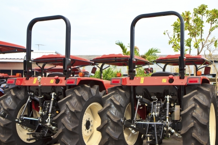 A row of new tractors for sale on the lot