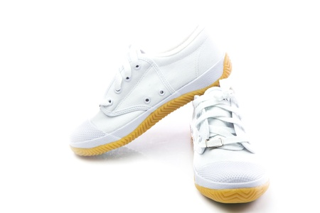 Pair of new white sneakers on white background. photo