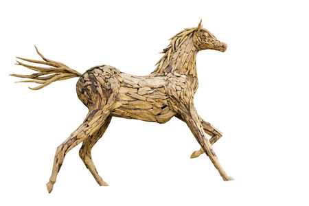 Beautiful sculpture of horse made of  wood isolated on the white background.