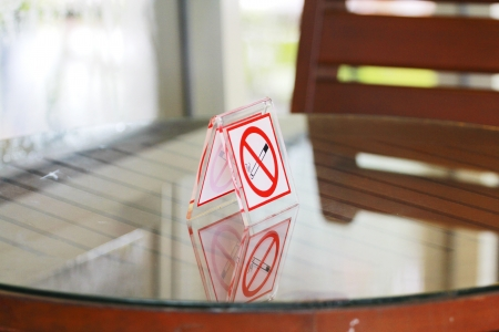 No smoking sign on  table. photo