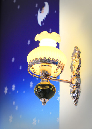 Lighted classic sconce on the wall. Stock Photo - 22427440