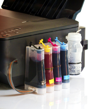Cartridges and containers of continuous ink supply system. photo