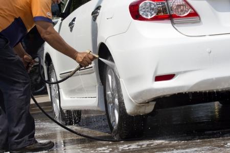 Car wash with flowing water  Foto de archivo