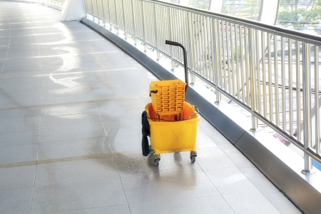 Mop bucket on floor in office building. Stock Photo