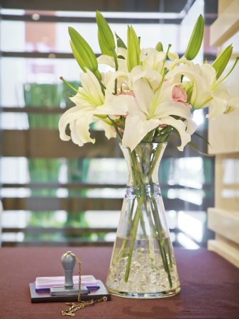 Bouquet of flowers in a glass vase. Stock Photo