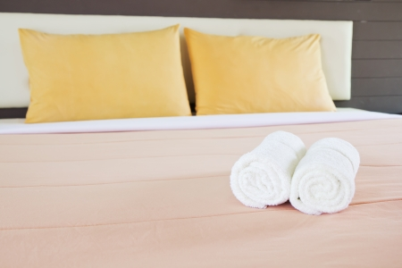 white towels: style bedroom interior with White towels and double yellow pillows Editorial