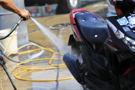 Washing the motorcycle.
