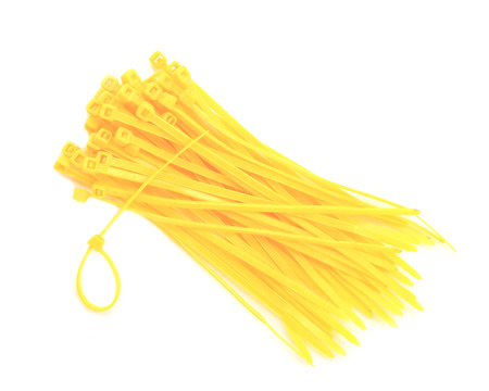 Yellow cable ties isolated against white background.