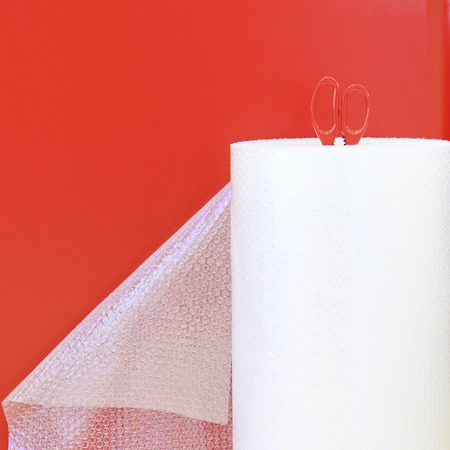 sealing tape: Bubble wrap used for packaging fragile items and scissor. Stock Photo