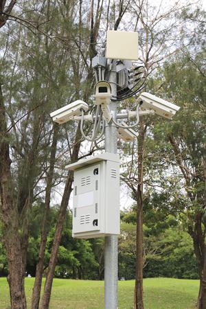 security surveillance cameras near green forest. photo