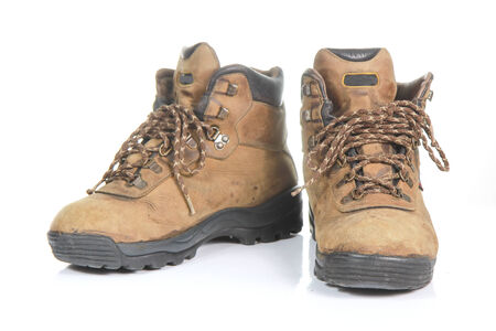 Pair of old yellow working boots Isolated on white background. photo
