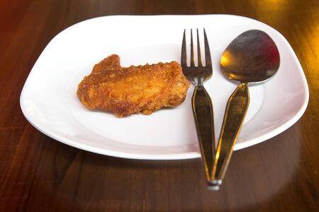 cast iron pan: Fried chicken in cast iron pan closeup.