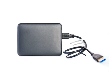portable hard disk: Portable external HDD hard disk drive with USB cable on white background. Stock Photo