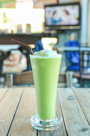 quencher: Ice Green tea with a straw.
