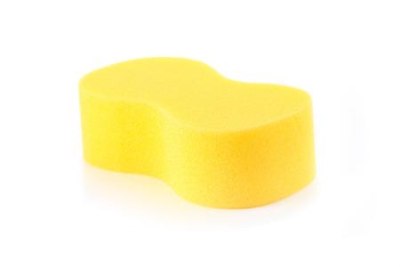 Sponge over white background. Yellow household cleaning sponge.