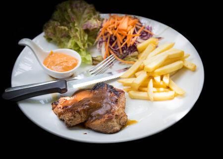 karaj: juicy grilled pork chop (neck cut) with greens.