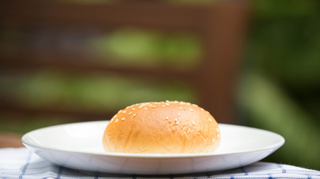 bread with sesame seeds on white plate.