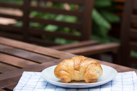 breakfast with fresh croissants. Stock Photo