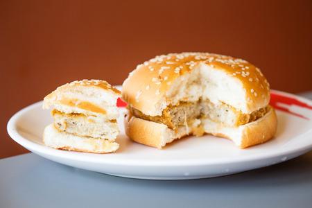 crisp chicken burger on white plate. photo