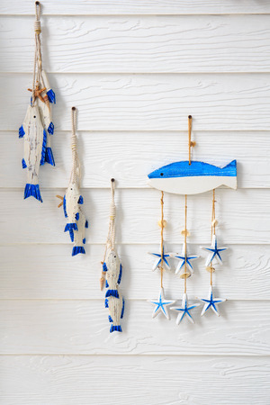 Set of wooden fish, hanging on wall. photo