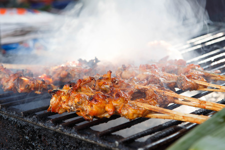 Barbecue with chicken  on grill. Banco de Imagens