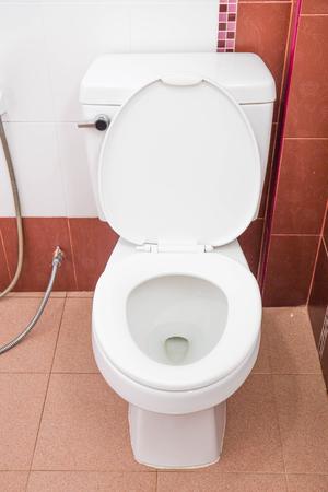 White toilet bowl in a bathroom. photo