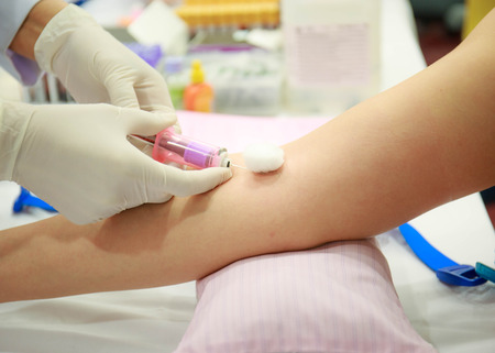 Young Woman Having Blood Test. Standard-Bild