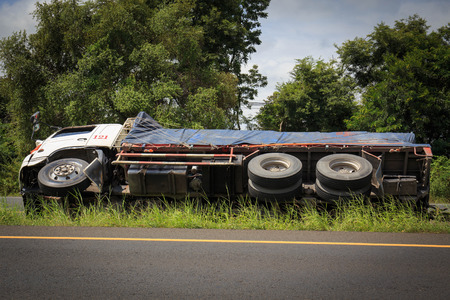 drive crash: overturned truck accident on highway road.