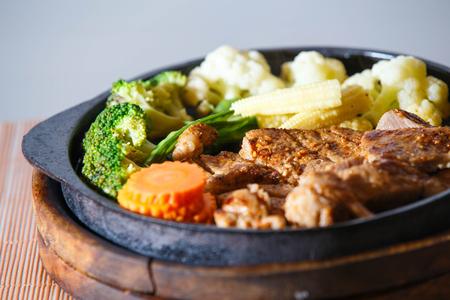 grilled pork chop: Juicy grilled pork chop (neck cut) with vegetables.