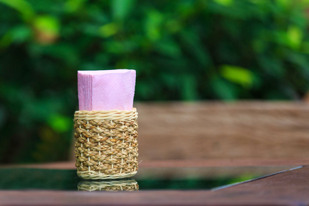 sniffles: Tissue paper box on glass table in restaurant. Stock Photo