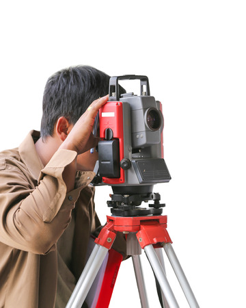Surveying measuring equipment level theodolite on tripod at\ construction site.