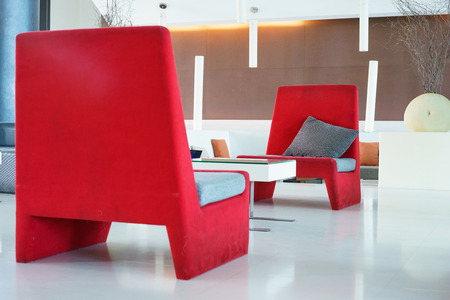 Lounge area of a hotel. Fragment of the modern lobby of the five stars hotel. Interior design. Stock Photo