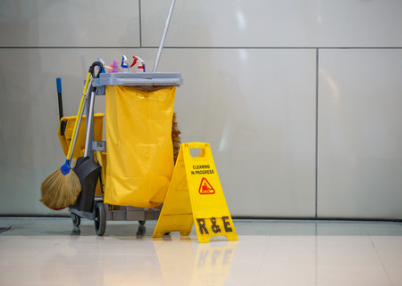 Mop bucket and caution sign.