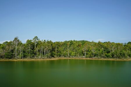 autumn landscape - lake and autumnal forest. photo
