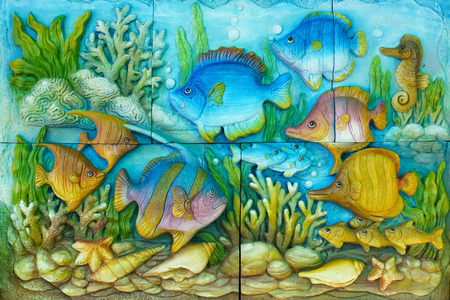 Thailand sandstone craft of marine fish. photo