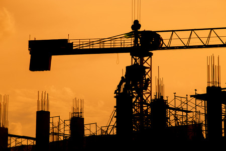 silhouette of construction worker on construction site.