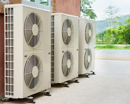 conditioning: Air compressor installation on pedestal.outdoor.