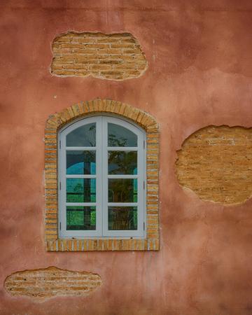 window pane: Old Brick Wall with White Window.