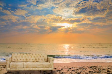 Armchair-Fabric arm chair on Sunset on tropical beach.