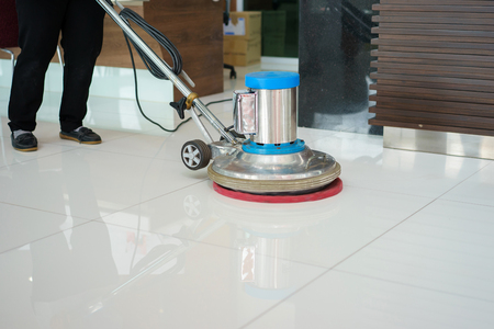 cleaning business: cleaning floor with machine.