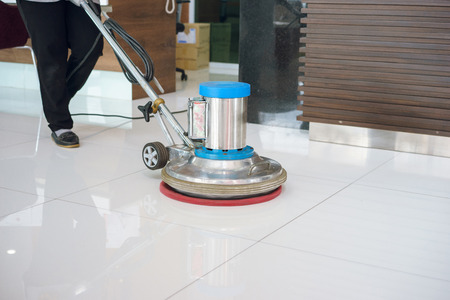 cleaning floor with machine.