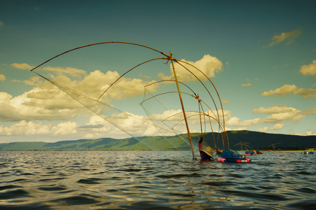 trawl: Traditional Catching fish with a net is one of the most popular method in  Area lake ,Thailand.